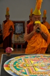 Vajra master deconsecrates the mandala