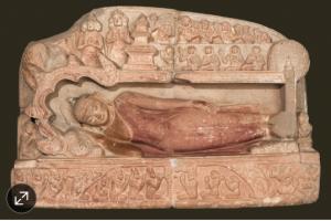 Scene of Buddha's death carved in sandstone around 1198 .